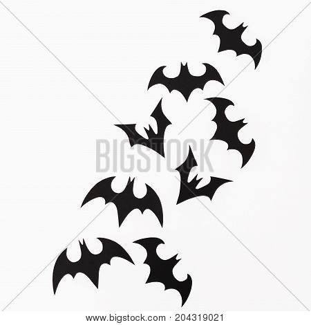 Halloween concept. Handmade black bats on white background. Flat lay, top view.