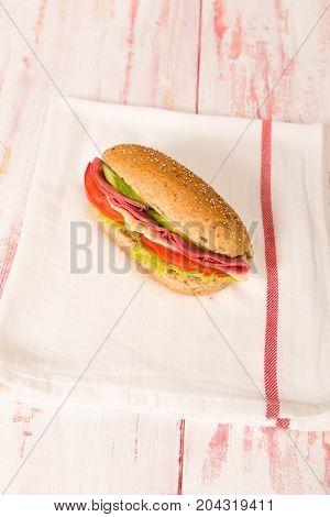 Fresh and tasty sandwich on cloth napkin