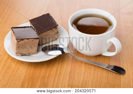 Cup Of Tea, Saucer With Cakes With Chocolate And Teaspoon