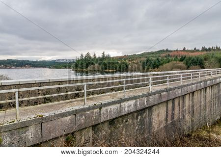 Loch Braden dam wall, Ayrshire, which has a walkway across the top of the dam wall.