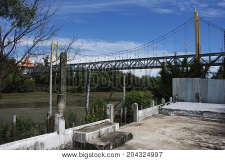 Suspension Bridge For People Crossover Chao Phraya River While Water Level Up At Estuary At Amphoe P