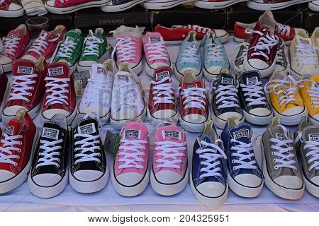 ATHENS GREECE - AUGUST 15 2016: Converse all star casual shoes colorful sports sneakers for sale.