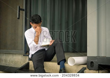 Portrait of worried businessman sitting after losing job stressed concept