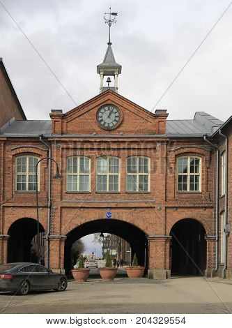 A clock tower above the entrance to old linen factory Tampella which is no longer in operation in Tampere, Finland
