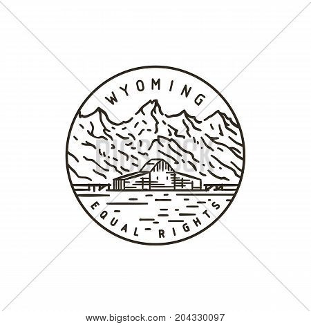 Vintage vector round label. Wyoming. Rocky Mountains