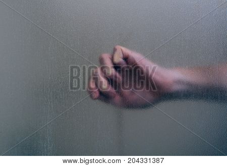 Creepy clutched hand in haunted house for Halloween fright