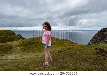 View of Girl looking out over Slieve League Cliffs, County Donegal, Ireland