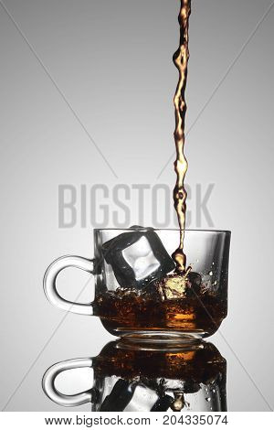 Ice Tea Poured into a Glass Tea Cup
