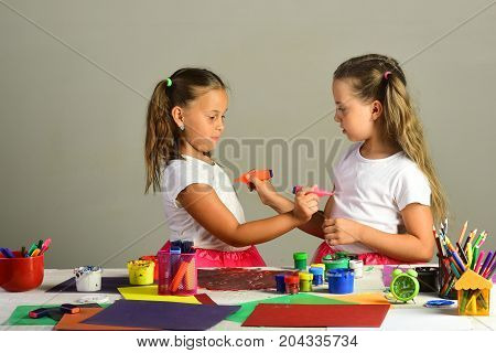 Creativity And Imagination Concept. Girls With Serious Faces