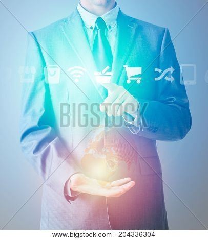 Businessman In Suit Choose From Icons With World Globe In Second Hand.