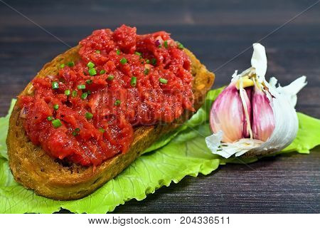 Toast with a tartar beef. Gourmet delicacy. Food meat toast yolk pepper salt and worchester sauce.