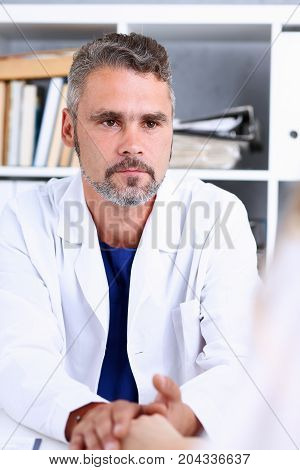 Friendly Male Doctor Hold Female Arm In Office