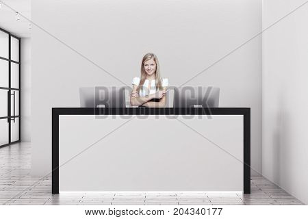 Cheerful young female secretary in modern office interior with reception desk. Work concept. 3D Rendering