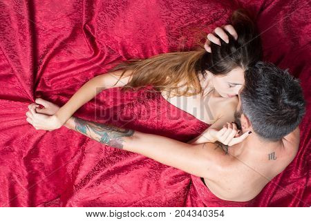 Man And Woman With Half Covered Bodies Kiss