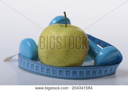 Dumbbells In Bright Green Color, Measure Tape And Fruit
