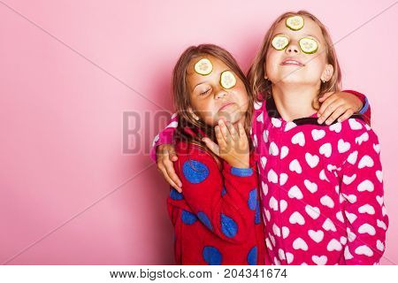 Childhood And Happiness Concept. Girls In Colorful Polka Dotted Pajamas