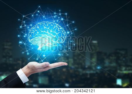 Businessman hands holding abstract polygonal brain on blurry night city background. Artificial intelligence and innovation concept