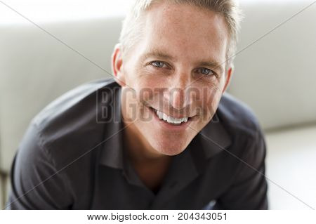 A Portrait of single 40s man sitting in sofa