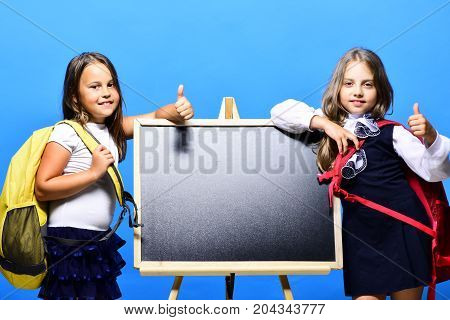 Girls With Smiling Faces And Thumbs Up. Back To School