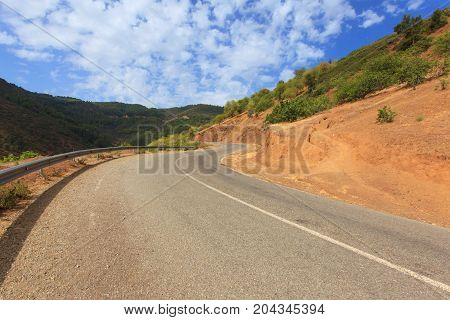 curvy mountain road Asphalt road in summer forest morocco lanscape.