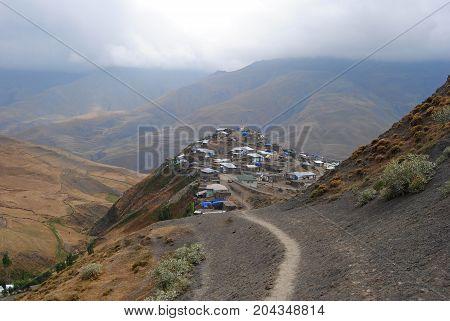 A narrow footpath connecting Xinaliq village in Azerbaijan to a cave on the northern slopes of Qizilqaya.