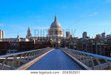 The view of the dome of Saint Paul's Cathedral and Millenium bridge , City of London, United Kingdom.