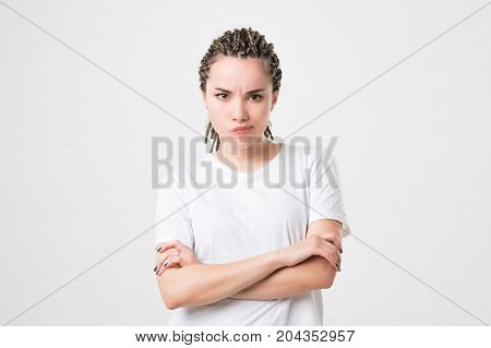 Caucasian young very unhappy woman, trying to argue or to complain, studio shoot isolated on white background