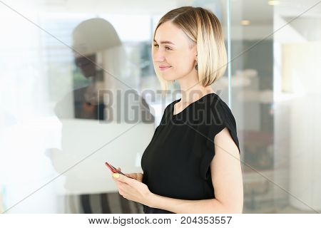 Businesswoman Holding Red Smartphone In Hand
