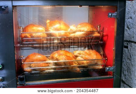 Chickens Cooking In A Rotisserie In The Street