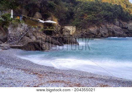 SAN FRUTTUOSO DI CAMOGLI (GE), ITALY - SEPTEMBER 10, 2017: The world famous beach of San Fruttuoso, little bay along the shores of the Ligurian Sea (Northern Italy), UNESCO World Heritage site.