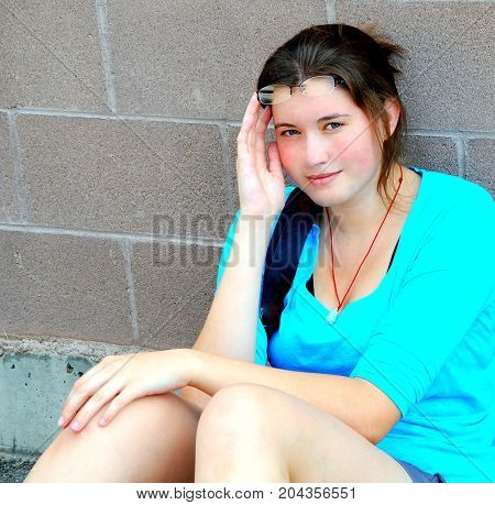 Female beauty fashion model expressions outside alone.