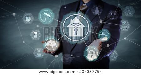 Blue chip business manager activating smart home application network in cyberspace. Technology concept for wireless security and home automation Internet of Things remote control and monitoring.