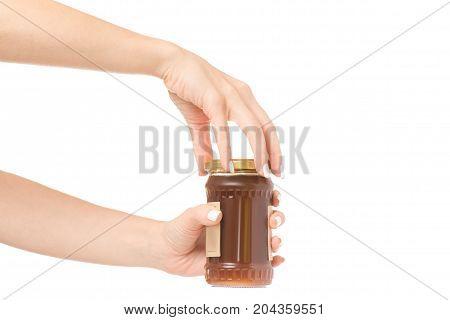 Female hands jar jam apricot on white background isolation
