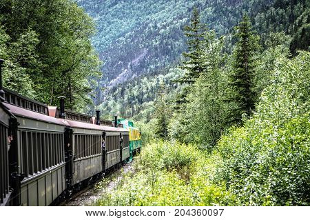 SKAGWAY ALASKA USA - JUNE 2017 - Alaskan Canadian White Pass train ride attraction through british columbia canadian rocky mountains