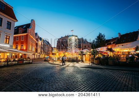 Riga, Latvia - July 1, 2016: Open Air Leisure Venue Recreation Center Egle In Evening Or Night Illumination In Old Town On Kalku Street.