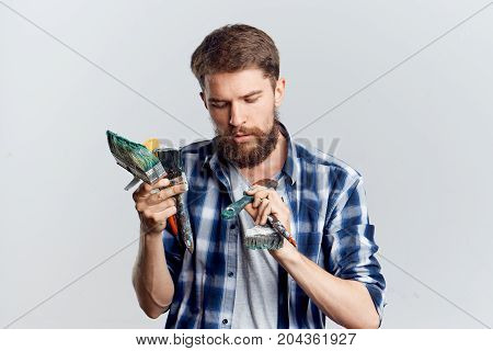 Young guy on white isolated background, repair, tools.