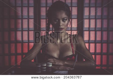 Sexy And Happy Female Poker Player