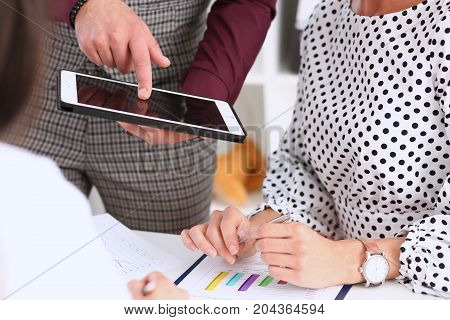 Businessman Points A Finger At The Tablet Holding It In His Hand