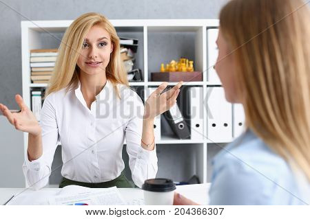 Young Couple Trying To Get Loan At Bank