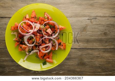 Tomatoes, Onion, Fennel On A Plate On A Wooden Background
