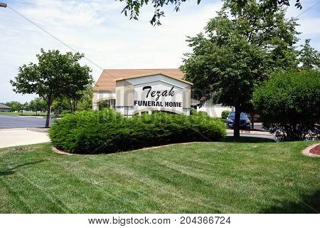 JOLIET, ILLINOIS / UNITED STATES - JULY 21, 2017: The Tezak Funeral Home offers funerary and mortician services on Plainfield Road.