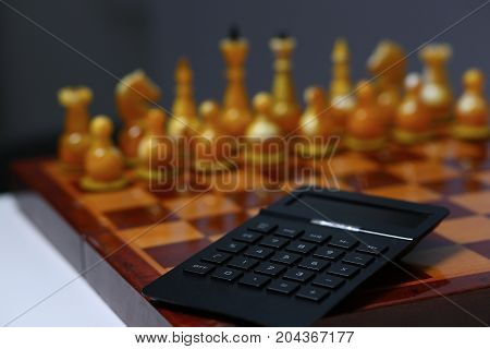 The Black Calculator Lies On A Chessboard.