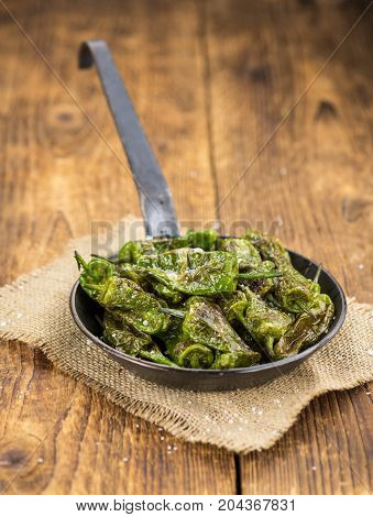 Fresh Made Pimientos De Padron On A Rustic Background