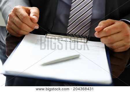 Male Arm In Suit Offer Contract Form On Clipboard Pad