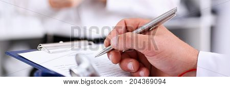Male Doctor Arm Hold Silver Pen