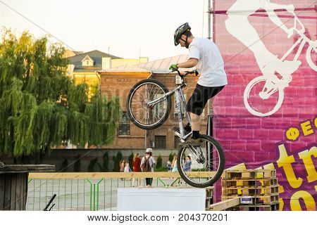 Man Keeping A Balance On His Trial Bike In The Park