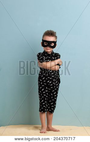 Little Boy In A Jumpsuit