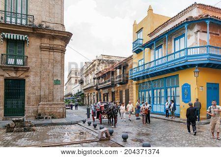 HAVANA CUBA - February 10 2008. Tourist walking on Obispo street. Famous haberdashery shop - Merceria La Munequita Azul.
