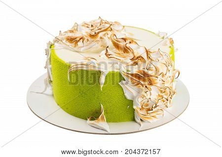 Birthday green colored cake with Italian burned meringue isolated on white background