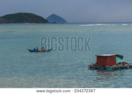 The Huts Of Vietnamese Fishermen On The Water